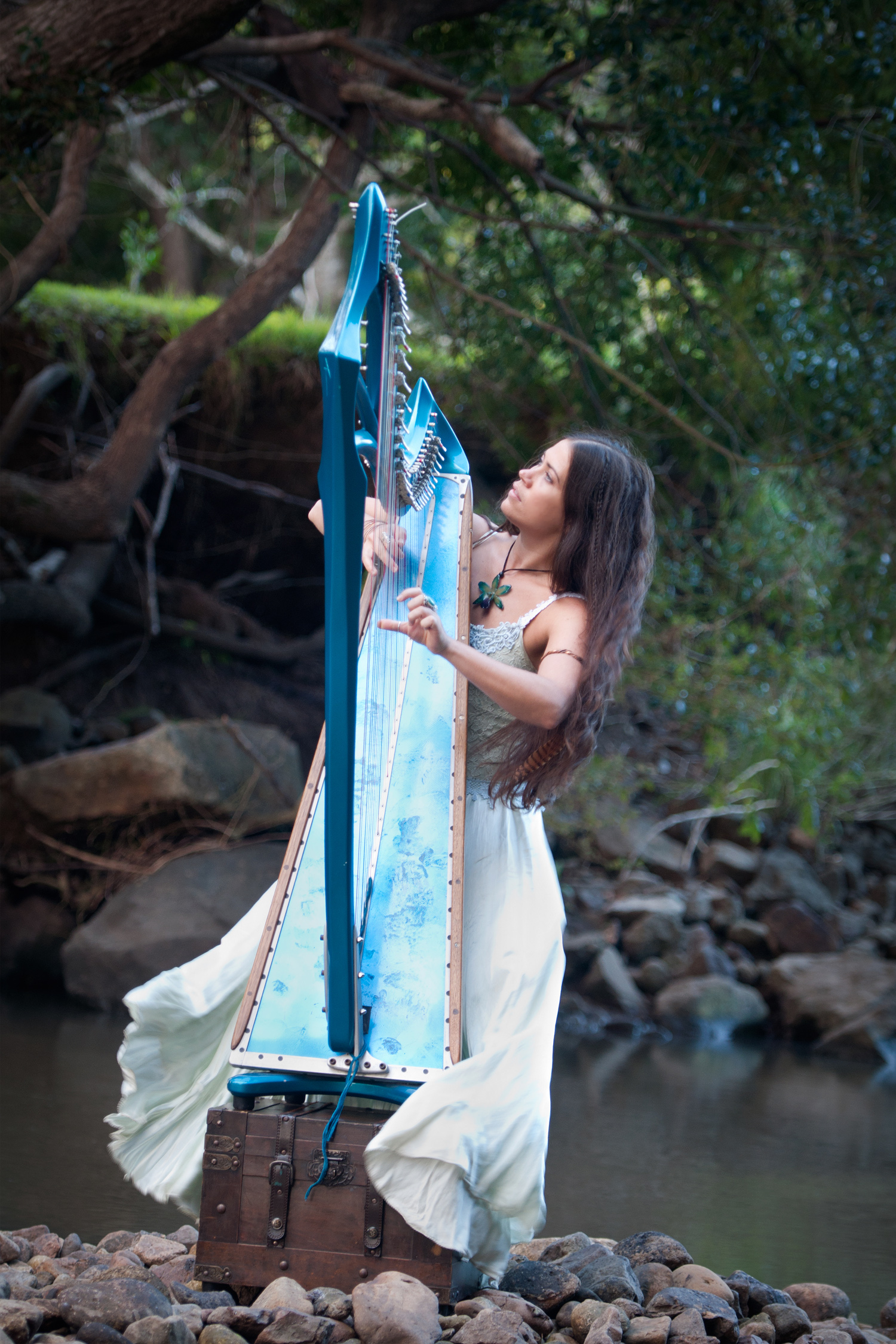goddess Kate playing her harp in the river bed